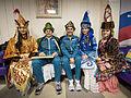 ISS-34 Oleg Novitskiy and Evgeny Tarelkin with women in ceremonial Kazakh dress.jpg