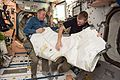 ISS-47 Tim Kopra and Tim Peake during Vestibule Outfitting in the Unity module.jpg