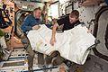 ISS-47 Tim Kopra and Tim Peake during Vestibule Outfitting in the Unity module.jpg