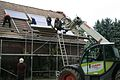 Installation of solar thermal collectors, assisted by forklift.jpg