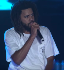 Cole performing in 2018