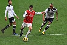 Fàbregas nella Premier League 2010-2011 contro il Tottenham