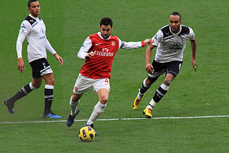 Jermaine Jenas - Jenas and Younès Kaboul against Arsenal's Cesc Fàbregas in November 2010