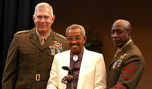 Josh Culbreath - Photo credit: Wandoo Makurdi, 2008. Culbreath (center) with Gen. James T. Conway (left) and SgtMaj Carlton Kent (left) accepts his induction into the Marine Corps Sports Hall of Fame.