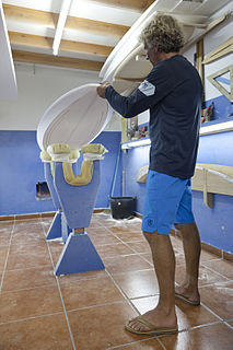 Surfboard shaper someone who builds and designs surfboards by hand