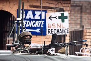 Armed Forces (Special Powers) Act - A soldier guards the roadside checkpoint outside Srinagar International Airport in January 2009.