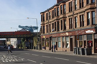 Clydebank - Kilbowie Road in Clydebank, featuring Clydebank railway station, with the skyline dominated by the Titan Crane.