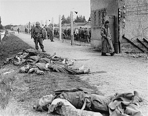 Dachau liberation reprisals - Closeup of the bodies of SS personnel lying at the base of the tower from which American soldiers had initially come under attack by a German machine gun.