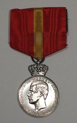 Kongens fortjenstmedalje H7 advers.jpg