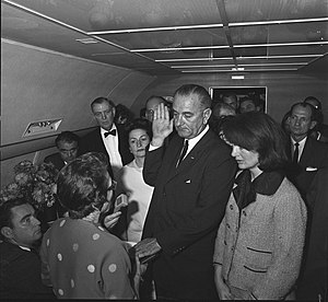 Sarah T. Hughes - Judge Hughes swears-in Lyndon B. Johnson as President of the United States as Mrs. Kennedy and Lady Bird Johnson look on. Photo by Cecil W. Stoughton.