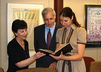 Mnachem Risikoff - Dr. Peggy Pearlstein, Head, Hebraica Section, African and Middle Eastern Division, U.S. Library of Congress, accepts two unpublished manuscripts written by Risikoff on behalf of the Library. Pictured with her are Risikoff's grandson and great-granddaughter, Rabbi Arnold Resnicoff and Malka Sarit Resnicoff. June 7, 2010.