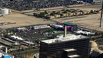 Route 91 Harvest festival - Main stage and artificial grass spectator area of Route 91 in September 2017, partially obscured by Luxor hotel block. Photograph taken from a helicopter during final preparations for the 2017 event.
