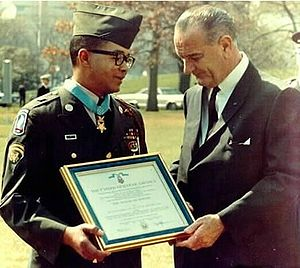 Specialist (rank) - President Johnson presenting a then-Specialist Six Lawrence Joel with Medal of Honor and Certificate