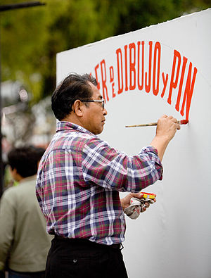 Sign painter in the Miraflores sector of Lima,...