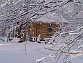 Log cabin covered in snow.jpg