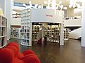 Looking through the shelves (3877608728).jpg