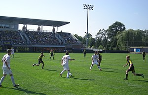 Loyola Ramblers men's soccer - Loyola (in white) playing against Michigan in 2013