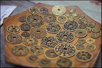 Chinese numismatic charm - Different types of Yansheng coins in Hội An, Vietnam.