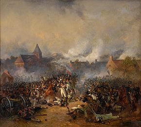 Painting of French and Prussian soldiers firing at each other while only a few meters apart with the Plancenoit church in the background