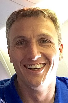 Lyndon Rive on a plane in 2019