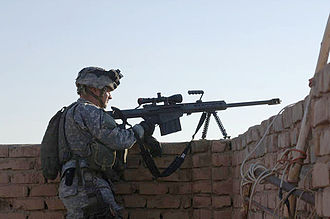 Barrett Firearms Manufacturing - A U.S. Army sniper with Bravo Company, 502nd Infantry Regiment, 101st Airborne Division stands ready to engage targets during a mission on the outskirts of Baghdad, Iraq.