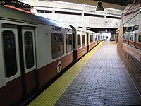 MBTA Red Line train departing Quincy Adams station.jpg