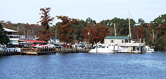 New Orleans metropolitan area - Madisonville's colorful waterfront, viewed here looking north from the drawbridge on LA 22, features outdoor dining along the Tchefuncte River estuary.