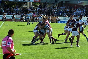 Tackle (football move) - A Rugby League tackle during a National Rugby League Match Between Manly Sea Eagles and Cronulla Sharks