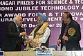 Manmohan Singh being presented a memento by the Union Minister of Science & Technology and Earth Sciences, Shri Kapil Sibal at the Shanti Swarup Bhatnagar Prize – 2007-08 and CSIR Awards – 2007 presentation ceremony.jpg