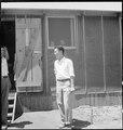 Manzanar Relocation Center, Manzanar, California. Evacuee of Japanese ancestry at this War Relocati . . . - NARA - 538073.tif