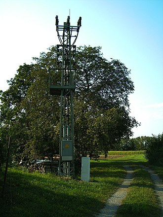 Undergrounding - A former pylon transformer south of Markgröningen, Germany. Today, the pylon carries only a switch fed by two underground cables.