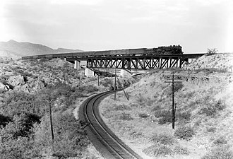 Sunset Limited - The train crossing Ciénega Creek near Vail, Arizona, in 1921.