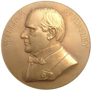Louisiana Purchase Exposition dollar - This McKinley medal by Chief Engraver Barber was used as the basis of the McKinley variety of the Louisiana Purchase Exposition dollar.