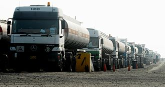Manufacturing Commercial Vehicles - A convoy of civilian Mercedes-Benz Actros trucks in Iraq waiting for inspection. The vehicles are built in the Cairo plant of MCV.