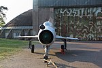 "MiG-21US Trainer. Received new silver paintshop and fake bort number ""Red 241"". Also faked roundell. Original bort number was ""246"". This particular aricraft served with JG-1 (""Jagdgeschwader 1"") and later FAG-15 (""Fliegerausbildungsgeschwader 15"", No. 15 training squadron) in de:Rothenburg/Oberlausitz. Now on display at Stendal-Borstel airfield, Stendal, Saxony-Anhalt, Germany."
