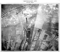 Annotated aerial photograph of the Mimoyecques complex showing railway lines overlaid on fields, with roads also marked