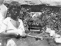 Mongondoupojke med den giftiga Lackesis- ormen på en gren - SMVK - 1989D.tif