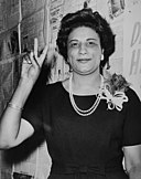Mrs. Constance B. Motley, first woman Senator, 21st Senatorial District, N.Y., raising hand in V sign.jpg