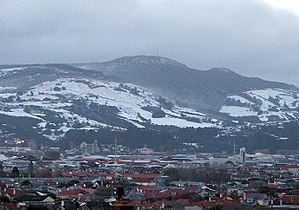Mount Cargill - Dunedin sits beneath the snowy mid-winter slopes of Mt. Cargill in this photo from July 2007.