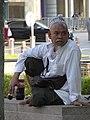 Muslim Man outside Petronas Towers - Kuala Lumpur - Malaysia (35498340431).jpg