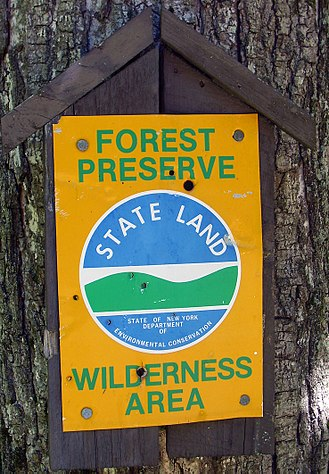New York State Department of Environmental Conservation - DEC sign marking state-land boundary.