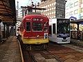 Nagasaki Tramway cars stopping at Nagasaki-Ekimae Station.JPG