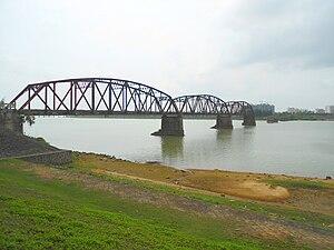 Nandu River Iron Bridge - A view from the eastern shore of the Nandu River, just north of the bridge