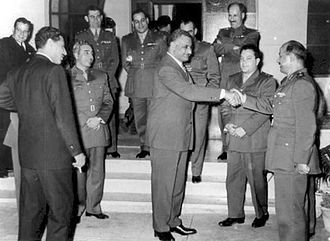 United Arab Republic - Nasser shaking hands with al-Bizri