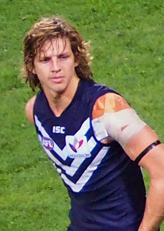 Fremantle Football Club - Nat Fyfe wearing Fremantle's home guernsey, introduced 2011