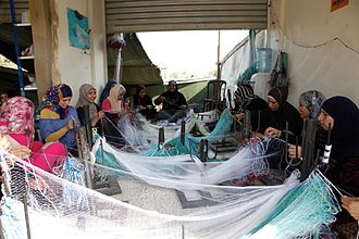 Retraining - These Syrian refugees and local Lebanese women are being retrained to make fishing nets.