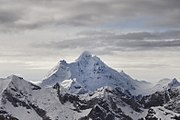 A large, snow-capped mountain stretching into the clouds.