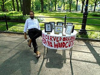 Norm Augustinus - Norm Augustinus Selling His Art in Central Park (photo by Ann Meir).