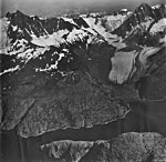 Northeastern Glacier, terminus of valley glacier, hanging glaciers with icefall on the mountainsides, and firn line, September 4 (GLACIERS 6681).jpg