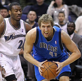 National Basketball Association - Dirk Nowitzki and John Wall in action as the Dallas Mavericks face the Washington Wizards in 2011